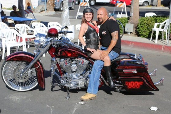 Omar Villa's Aztec-red custom took the top spot in the Custom Bike Competition and earned him a photo op with Roadshows girl Amberleigh Gilmore