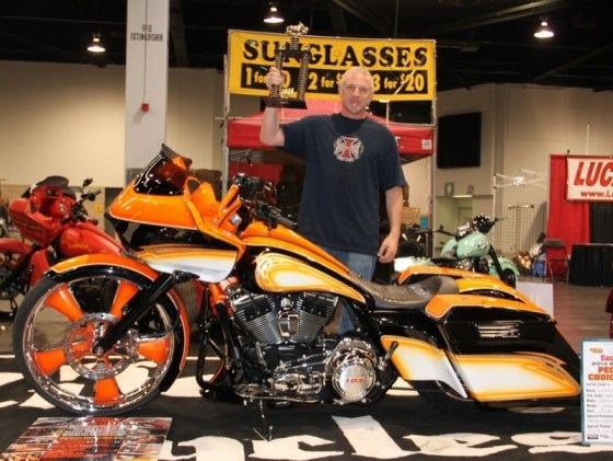 Junior Skolnick of LifeStyle Cycles with his Baddest Bagger-winning bike and trophy
