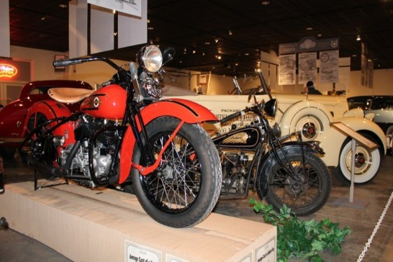 A 1937 Harley-Davidson UL and 1934 Indian Four blend in with the four-wheeled relics at the National Packard Museum