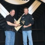 Griff Allen congratulates Terry Vance of Vance & Hines for earning the Lifetime Achievement Award