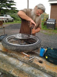 Panhead Billy does the maintenance on his bike on the road - Photo courtesy of Panhead Billy