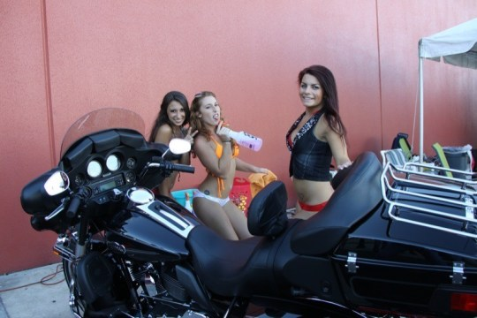 The bikini bike wash team takes a break after a hard and wet day at work