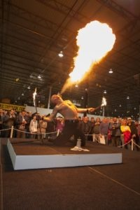The fire breather wows awed onlookers at the Gibraltar Trade Center