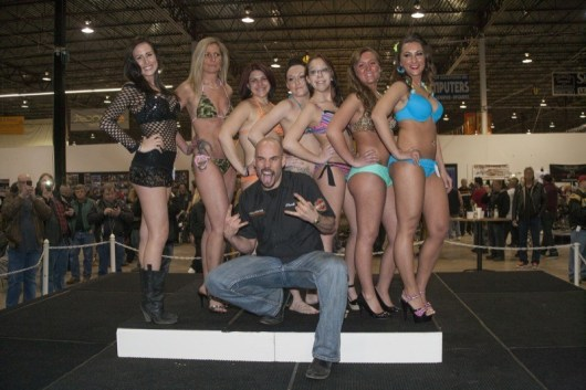 Bikini contest emcee Chuck with the lovely ladies who vied for the $1,200 in prize money that was up for grabs
