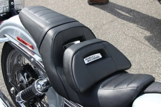 The bolster seat attachment shoves a rider's but 1 1/2 inches closer to the bars without compromising appearances