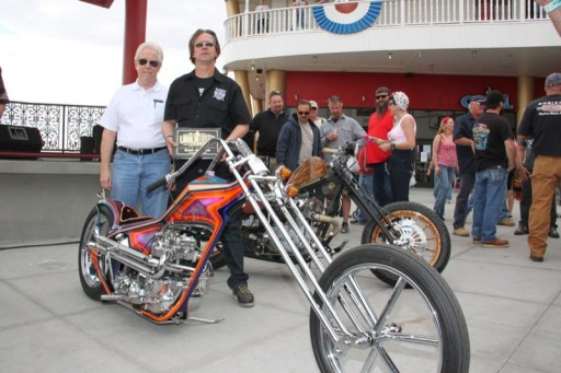 """Joe O'Day of Dalcon Promotions with Paul Ponkow of Bones Legacy Choppers, who scored Best of Show at the Belle for """"Black Rainbow"""""""