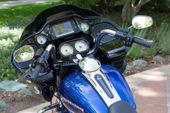 New handlebars and repositioning of the fairing reduce rider reach to instrumentation and controls