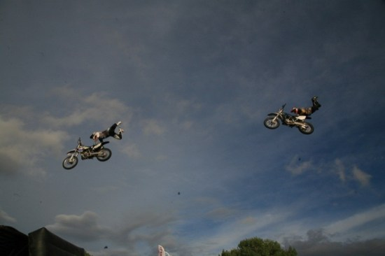 Members of MOB FMX put on several stunt shows in between rain showers. Ben Veyne (left) and Devon Hoyer perform the Superman stunt in the air at the same time.