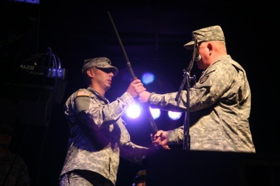 Michael McNamara (left) of the 593rd MTC Nevada National Guard, named this year's Soldier of the Year by Winnemucca, receives a Remington 870 Shotgun from Brigadier General Todd Plimpton at a special presentation Saturday night