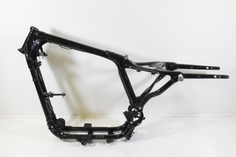 """Similar, but even stouter (and heavier) rubber-mount XL frame… with us since 2004. Spot what happened at the swingarm pivot… it's an insight into where the """"hinge"""" is that allows most wiggles and weaves in turns. This treatment by H-D pretty much precludes any issues… but look at some of the other frames from back in the day and it creeps you out, how flimsy and flexible they are in this area."""