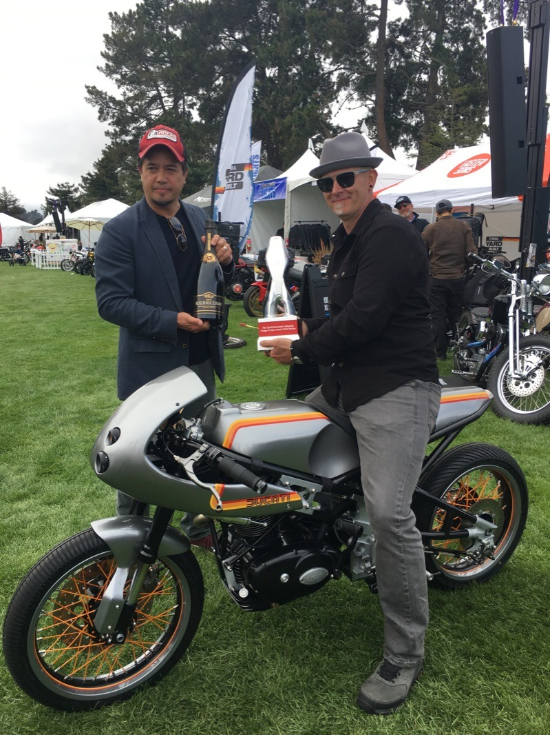 Tony Prust of Analog Motorcycles receiving the Design and Style Award from Gard Hollinger of Arch Motorcycles