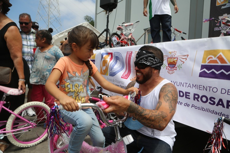 The look on Rolling Deep's Ram Casillas's face as he gives a lucky girl a bicycle says it all. One of dozens of bicycles given away to the children of Rosarito.