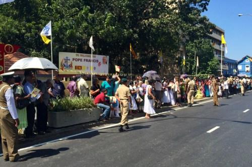 crowds line street-al jazeera