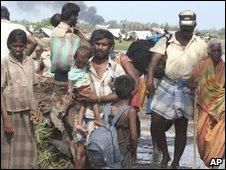 102c-perhaps Tamil refugee stream April 09-- AP ++