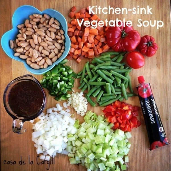 diced vegetables to make Kitchen Sink Vegetable Soup - diced carrots, green beans, green bell peppers, celery, onions, garlic, red bell pepper, white beans, tomato paste, vegetable stock