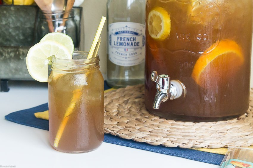 This Adults-Only Sweet Tea Punch recipe with hints of brown sugar, bourbon, and citrus is sure to be the star of your next outdoor cookout.