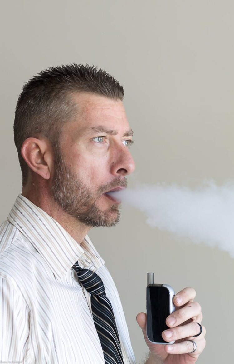 good looking guy vaping - Crush Your New Year's Goals + Cue Vapor