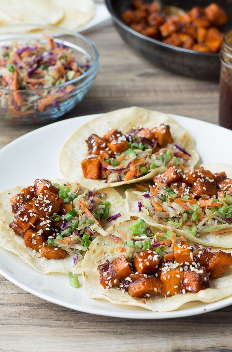 vertical wide view of the Mongolian BBQ Sweet Potato Tacos with broccoli slaw and Mongolian BBQ sauce