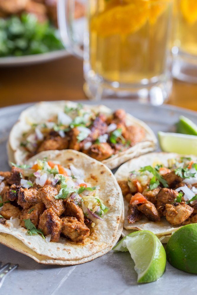 Tacos al Pastor topped with pineapple salsa
