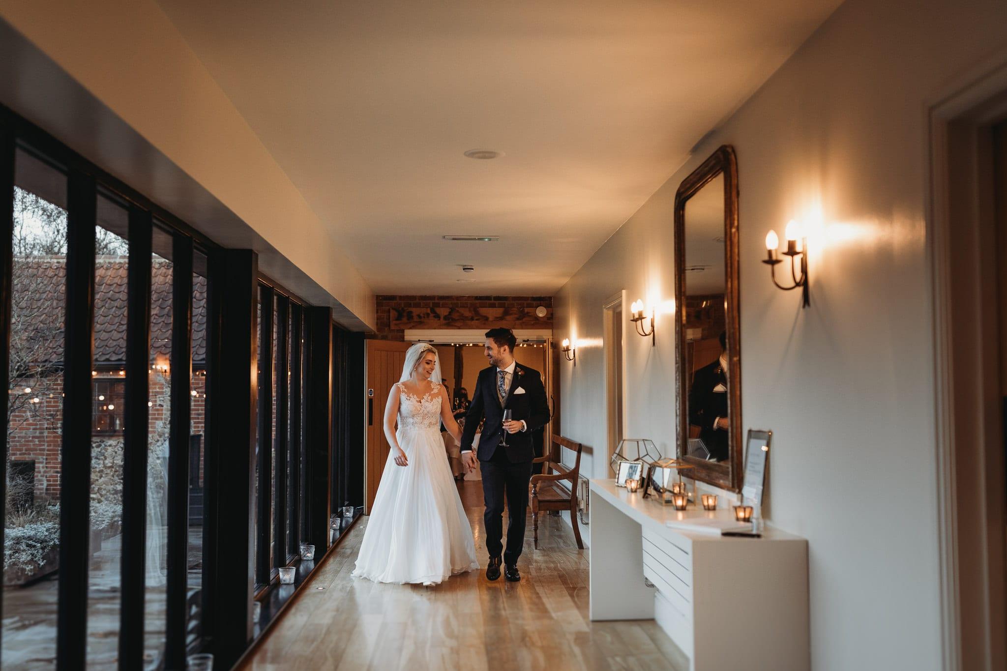 bride and groom walking on the corridor at Granary Estates Intimate wedding