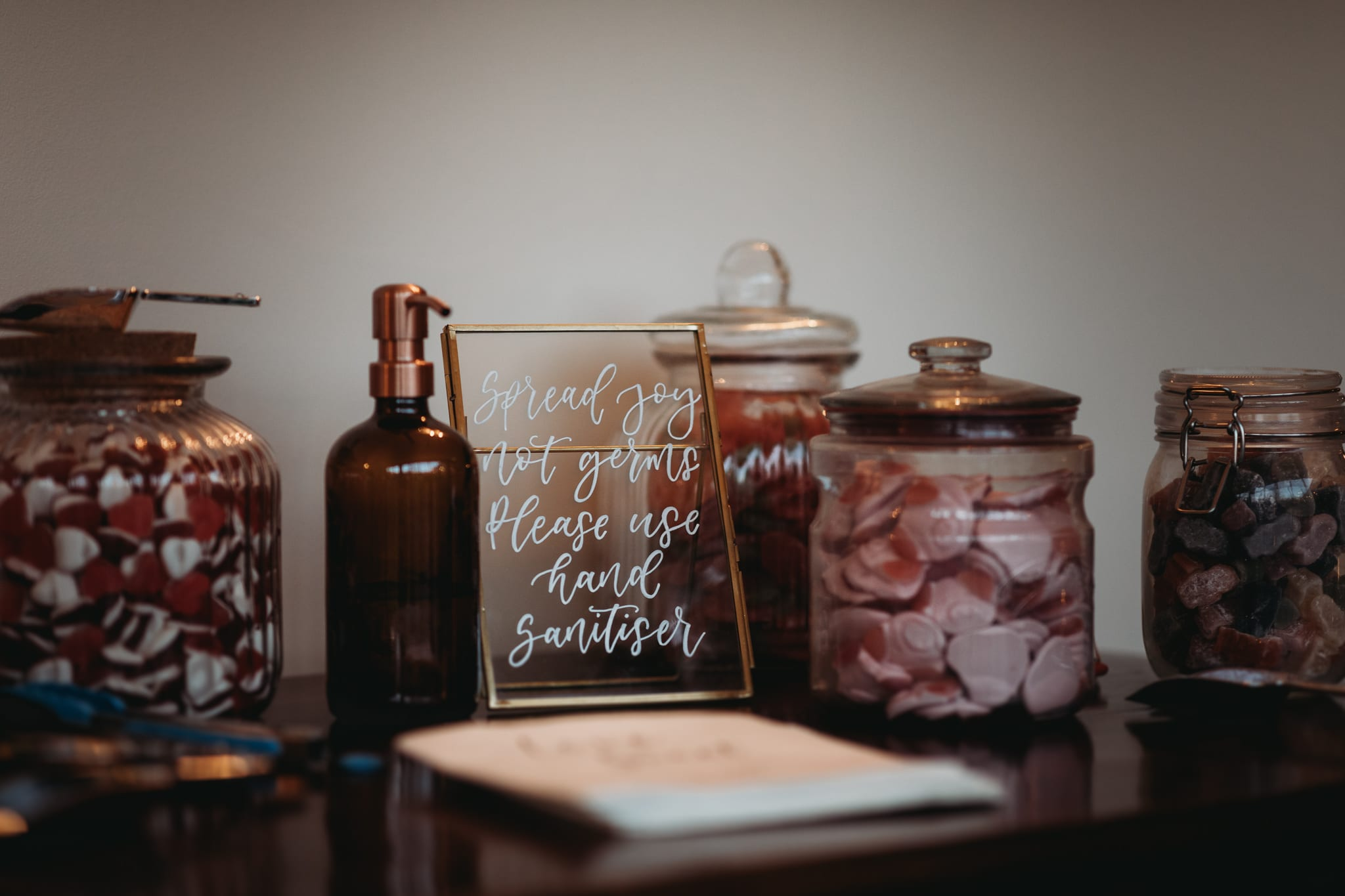 sweets table and hand sanitiser sign at Granary Estates Intimate wedding