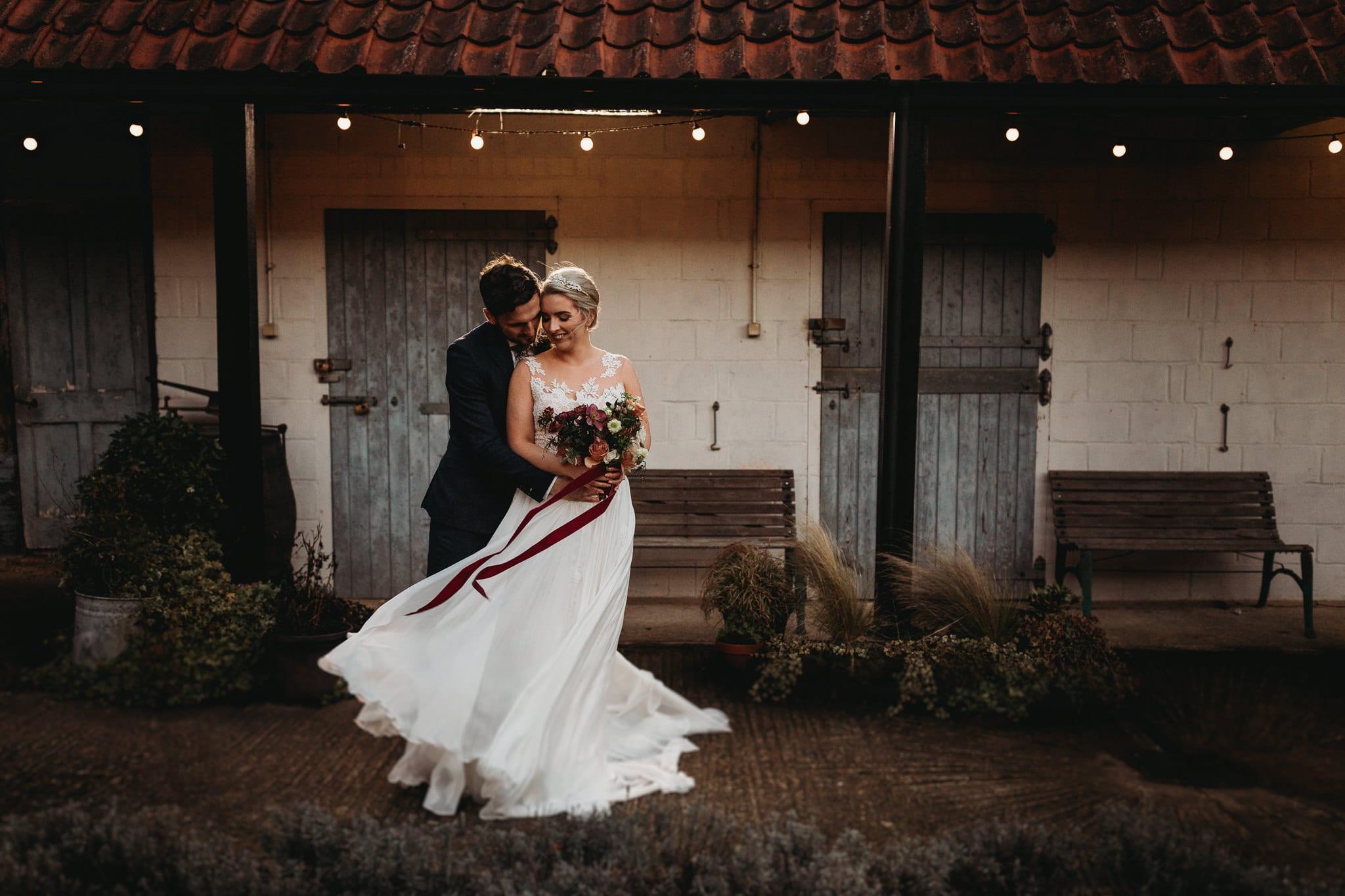 groom holding bride at Granary Estates Intimate wedding