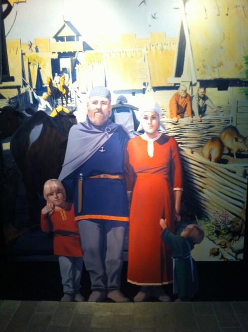 Viking museum in Århus - Aros - Viking family greeting visitors at the door.