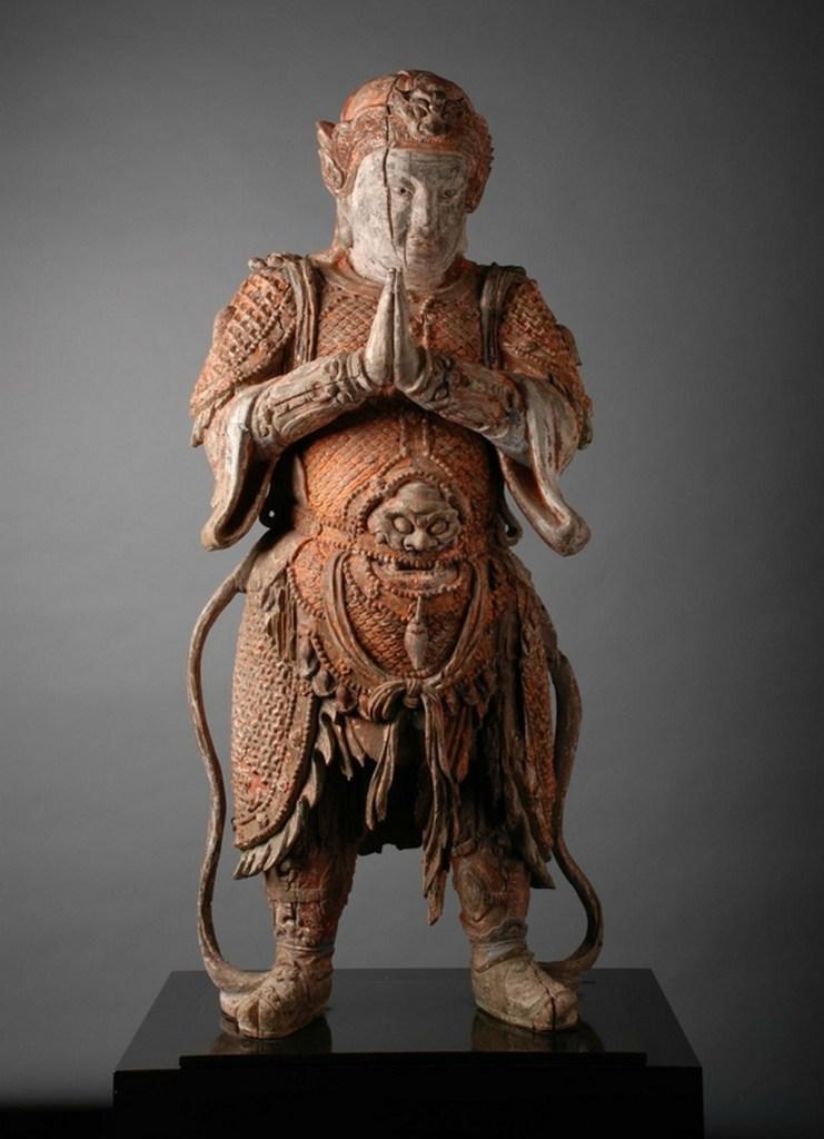 Figurine en bois sculpté représente la divinité bouddhiste Wei Tuo Pusa.