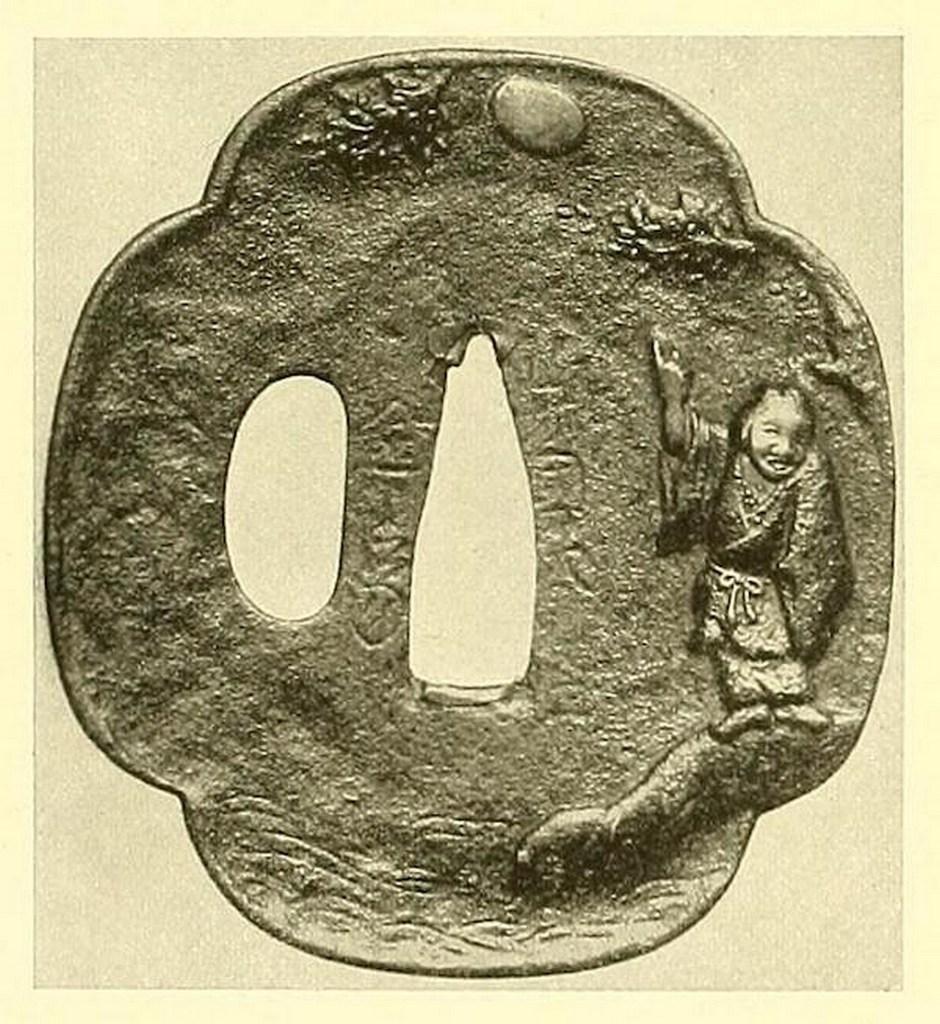 Tsuba en fer. Relief incrusté d'argent et d'or représentant le sennin