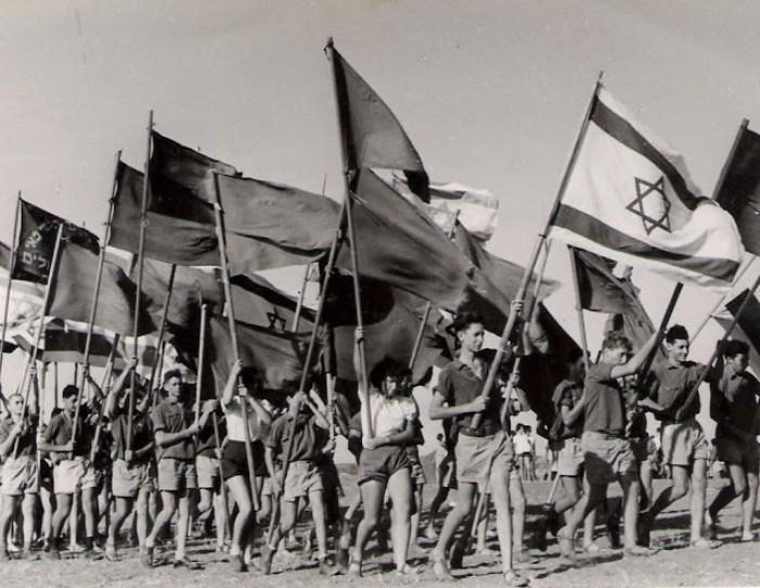 A ceremony on an Israeli kibbutz in July 1951. Wikimedia Commons