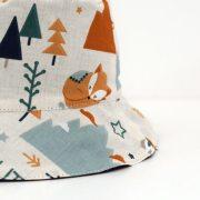 Gorro reversible con bonito estampado de animales. Ideal para proteger del sol a niños y bebés.