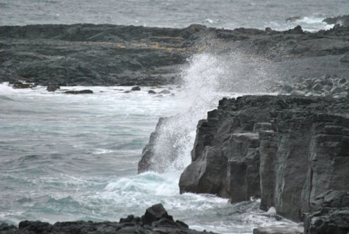 Ocean's waves breaking into the cliffs