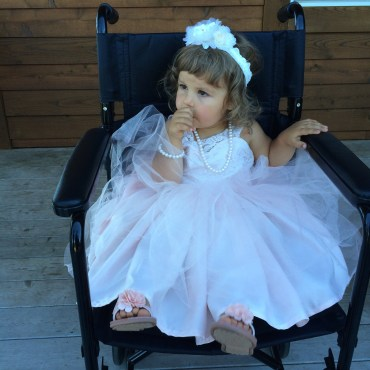 My niece as a Flower Girl waiting in my chair :)