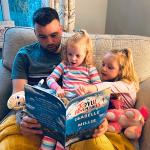 "Family reading ""The Joyful Adventures"""