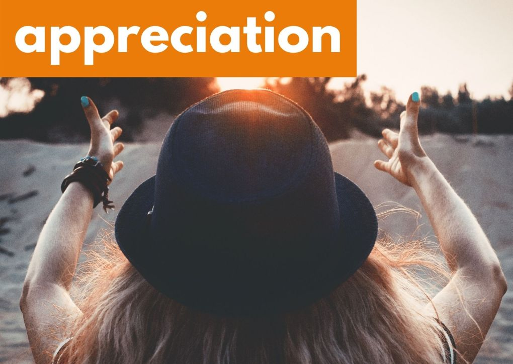 A woman with her arms outstretched and the word appreciation