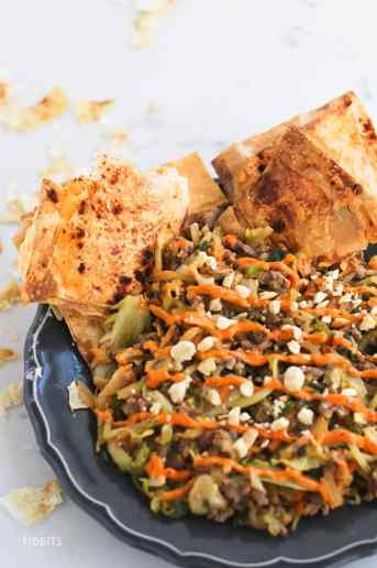 Veggie packed, deconstructed egg roll in a bowl with a crispy phyllo cracker. All the flavors of a traditional restaurant egg roll, minus the deep fry!