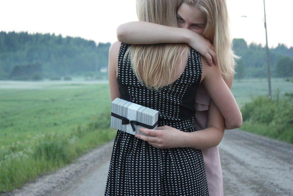 People matter lesson. Girls hugging.