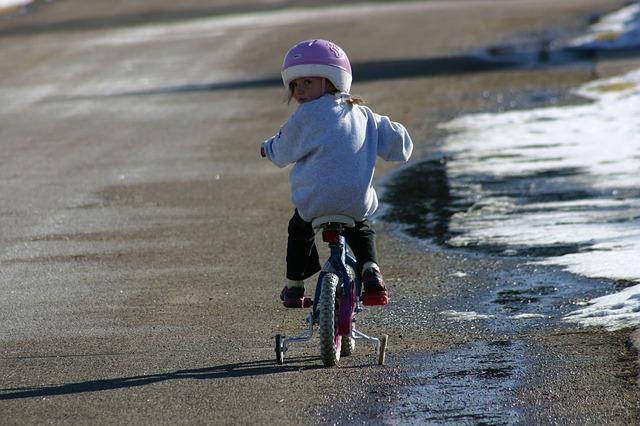 outdoor fun for march break child on bike photo