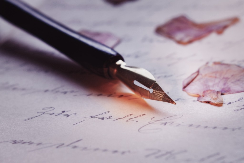 picture of a calligraphy pen on writing paper