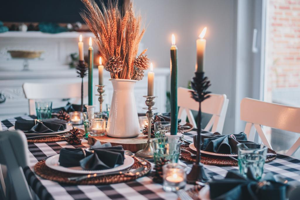 Photo of a dinner table set with napkins and candles