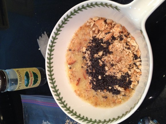 Butter, crushed crackers and poppy seeds