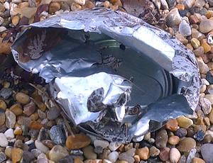 Aluminium can being eroded by the sea