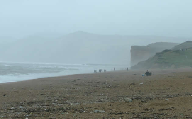 Low cloud and spray at Cogden Beach looking back to Burton Bradstock
