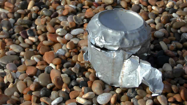 Battered drink can on Hive Beach