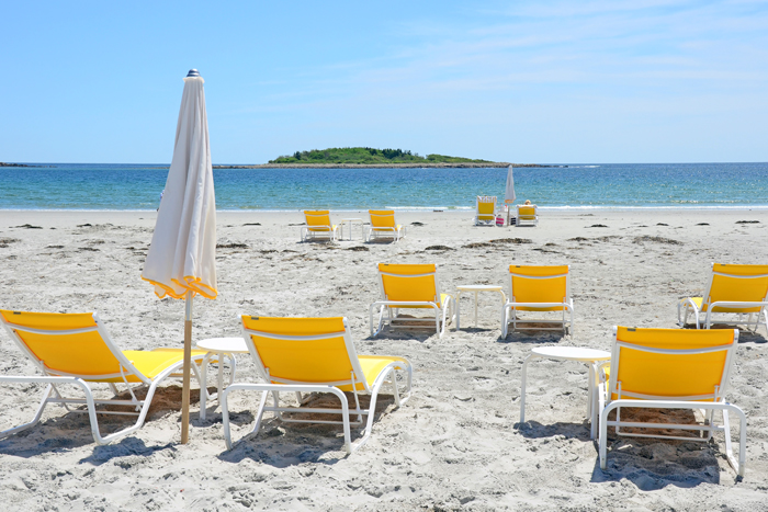 Goose Rocks Beach in Kennebunkport with yellow chaise lounge chairs