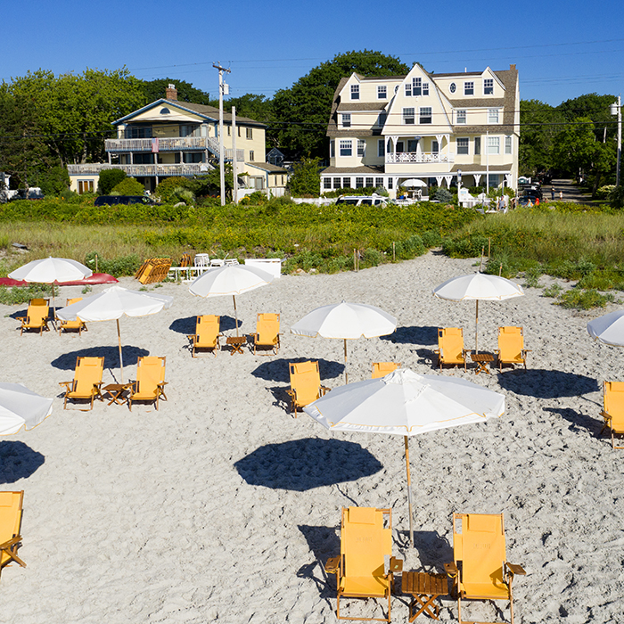 the tides beach club yellow chairs and white umbrellas on goose rocks beach kennebunkport resort collection hotel