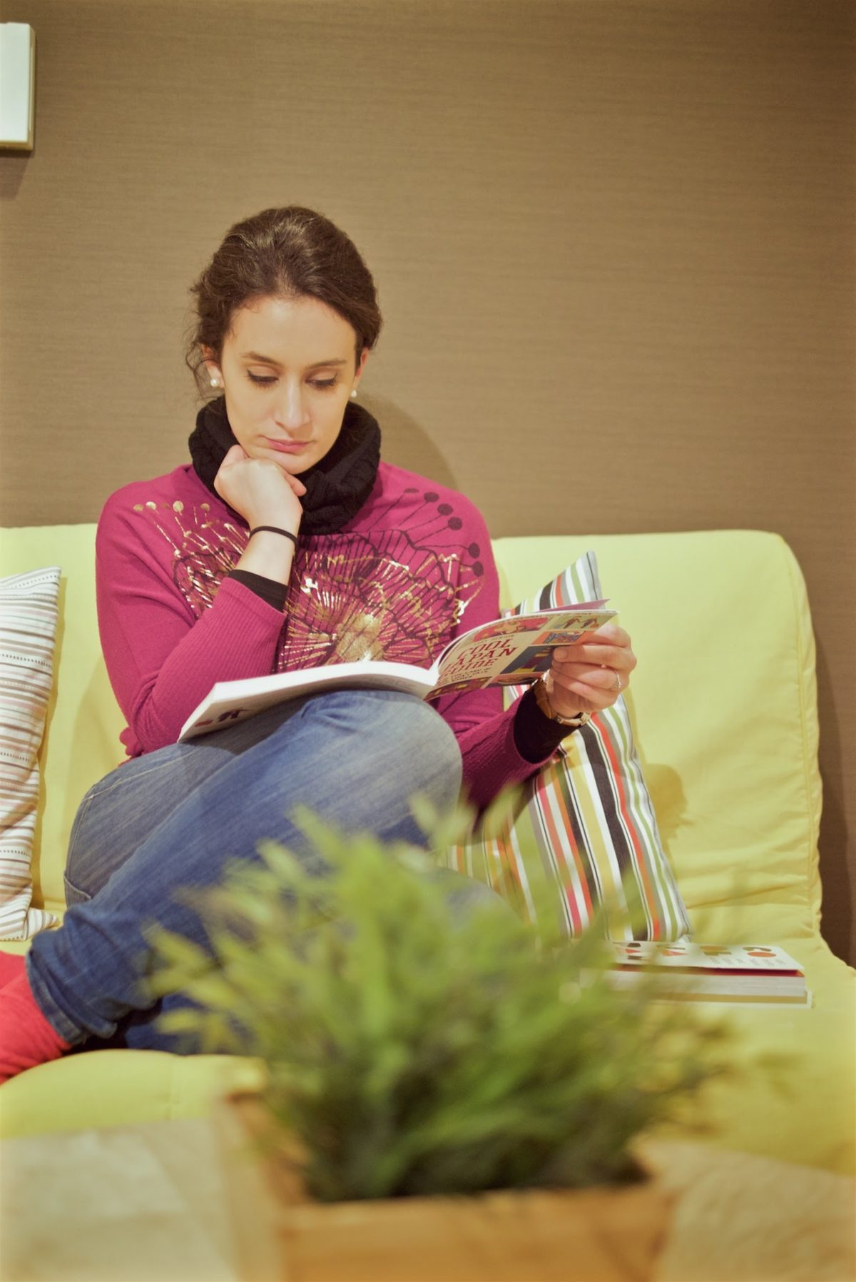 Girl reading a magazine
