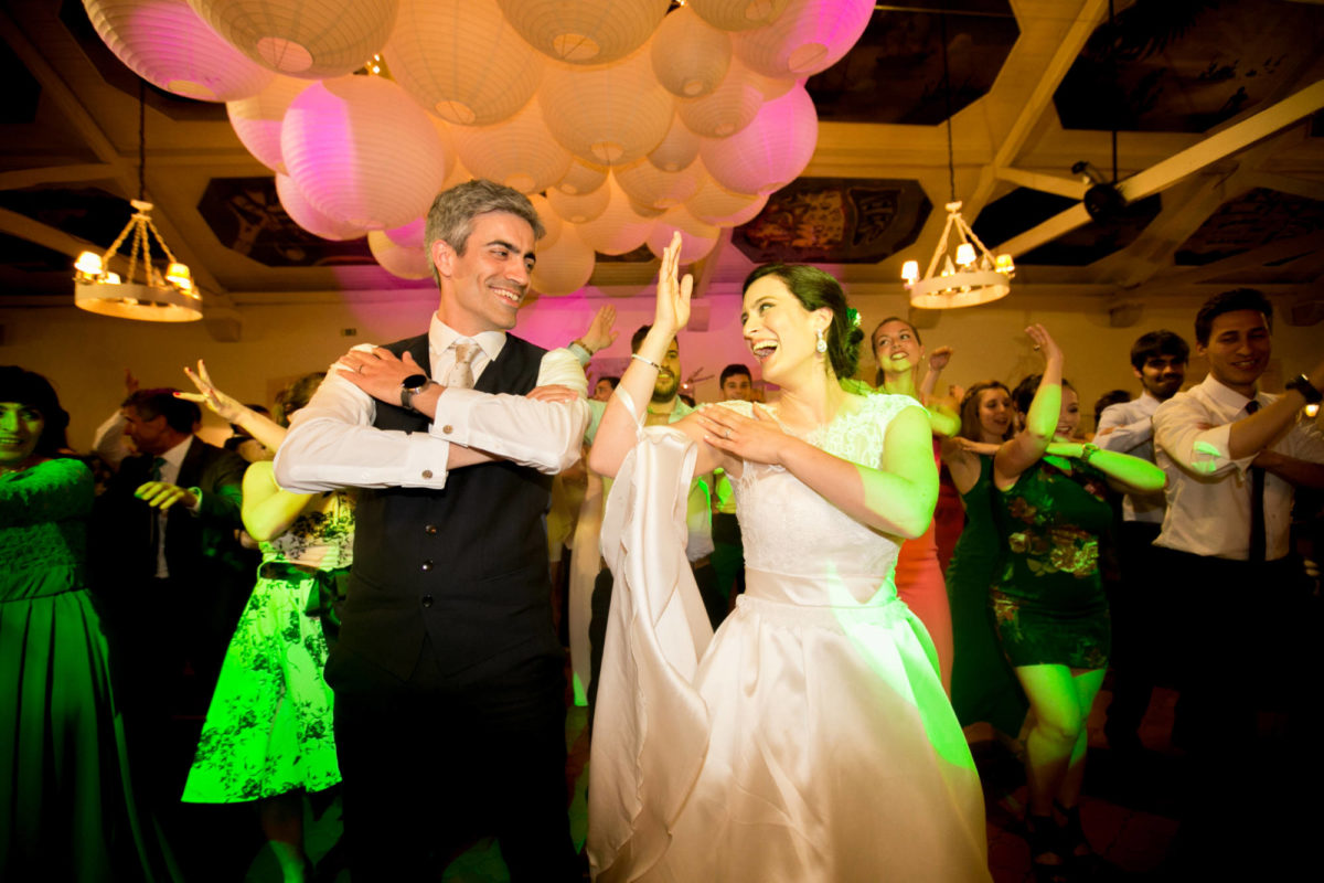 Bride and groom dancing to Macarena