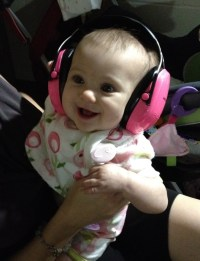 She wore her earmuffs at the wedding! No loud music for this girl!