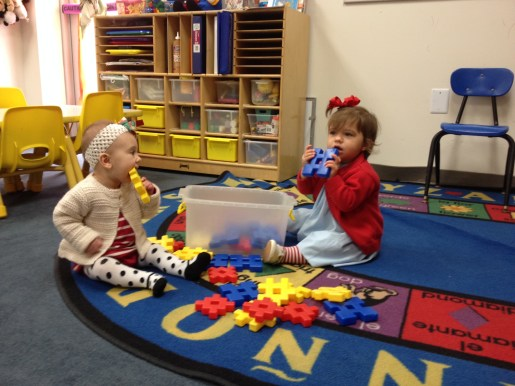 Playing with her BFF at school.